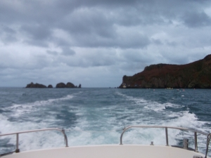 Sark landing in the distance on the right